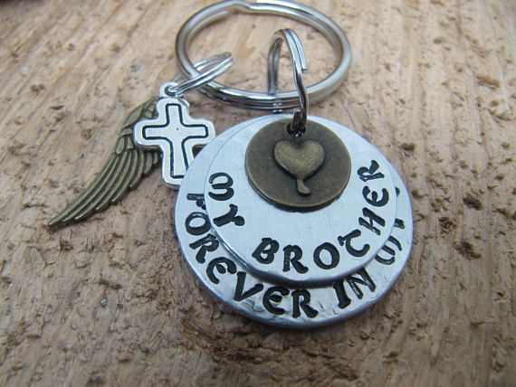 A special key chain to remember a brother or someone else that has passed. A beautiful gift to give in place of a sympathy card and can be mailed directly to someone with a card enclosed at your request. You may have any person you wish stamped on the top disc: Grandma, Dad, Father,