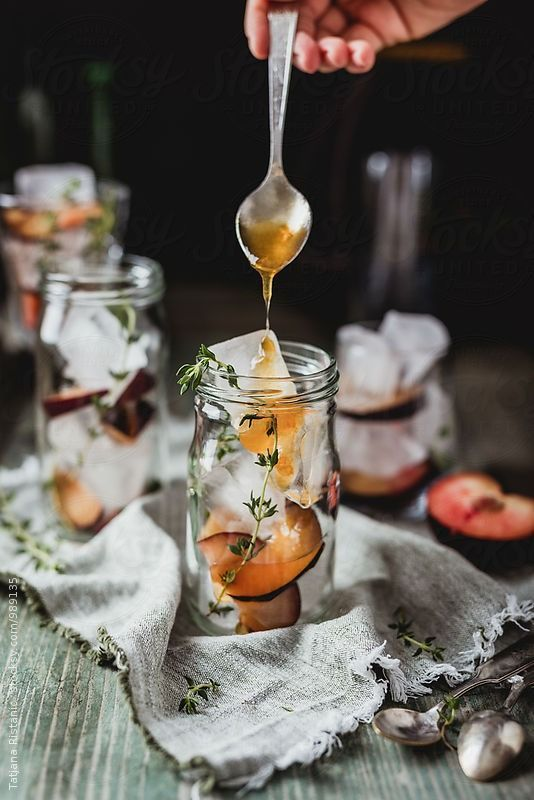 Making plum cocktail with apricot syrup and prosecco