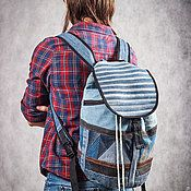 Купить или заказать Рюкзак джинсовый 'Карманы' в интернет-магазине на Ярмарке Мастеров. Рюкзак в технике пэчворк из темно-синей и светло-голубой джинсовой ткани. Унисекс, подойдет и мальчикам, и девочкам.Лямки длиной 70 см простеганы, регулируются по длине в большую сторону. Дно круглое. Спинка простегана, внутри есть карман формата А4 и карман на липучке. Снаружи карманы, штук 10, если не больше. Есть подвесная петля. Может использоваться как школьный, места для всего хватит.