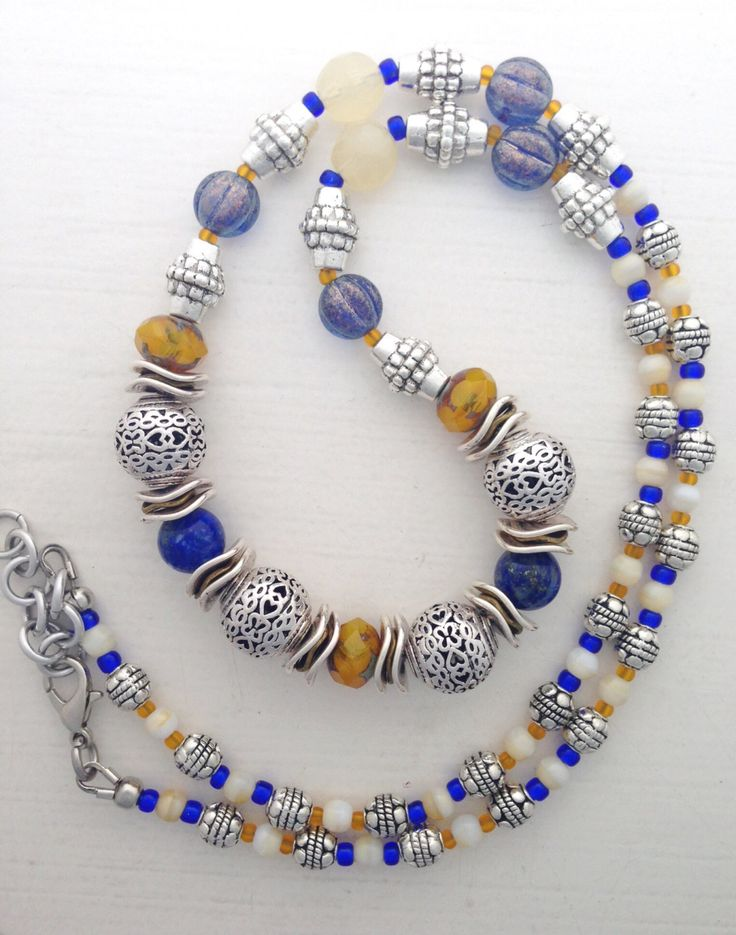 "Beaded necklace in blue, burnt orange, ochre, cream, and silver, 22"" - 23"" by ShereesTrinketBox on Etsy"