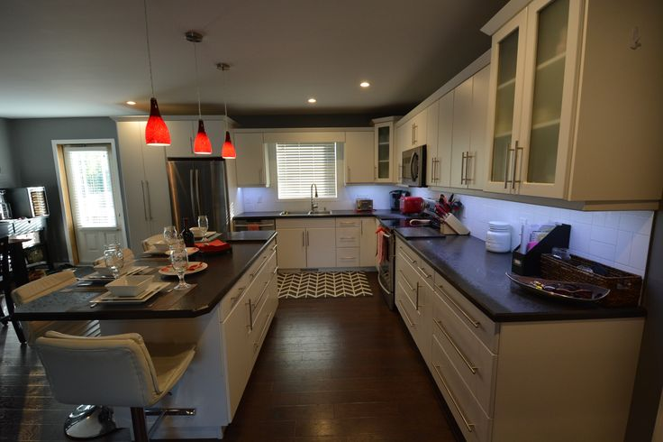 Simple white kitchen with red accents