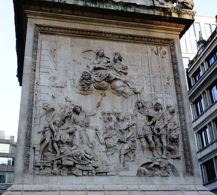"A freize at the foot of ""The Monument"" in London. The allegorical sculpture at the pedestal (shown) was executed by Caius Gabriel Cibber. The monument was built to commemorate the great fire of London. Photo by Alison Chambre."