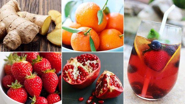 Ginger Pomegranate Cooler with sliced ginger, oranges, strawberries and pomegranate