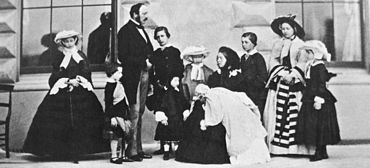 Prince Albert, Queen Victoria and their nine children, 1857. Left to right: Alice, Arthur, The Prince Consort, The Prince of Wales, Leopold (in front of him), Louise, Queen Victoria with Beatrice, Alfred, Victoria and Helena.