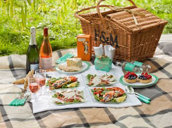 FORTNUM & MASON - For special occasions, let the experts pick you the finest produce. Beef carpaccio, dressed lobster, stilton with walnut wafers, fruit tarts, and Marc de Champagne Truffles make up their Wicker Picnic alongside a bottle of sparkling wine and English Rosé.
