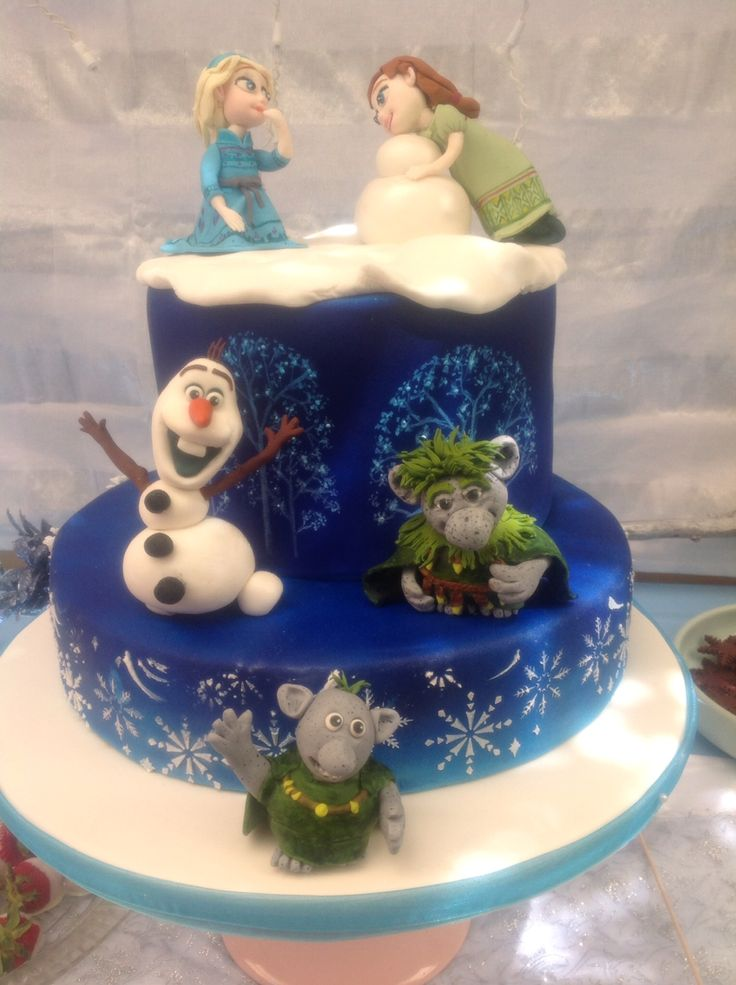 My Frozen themed cake for Ruby's 5th birthday. I decided to have Elsa and Anna playing as children to bring a sense of fun. Olaf is there simply because he is such a wonderful, joyful character. The trolls were there for a bit if magic. I was surprised at how much I enjoyed making Grandpappy Troll - troll sugar therapy!