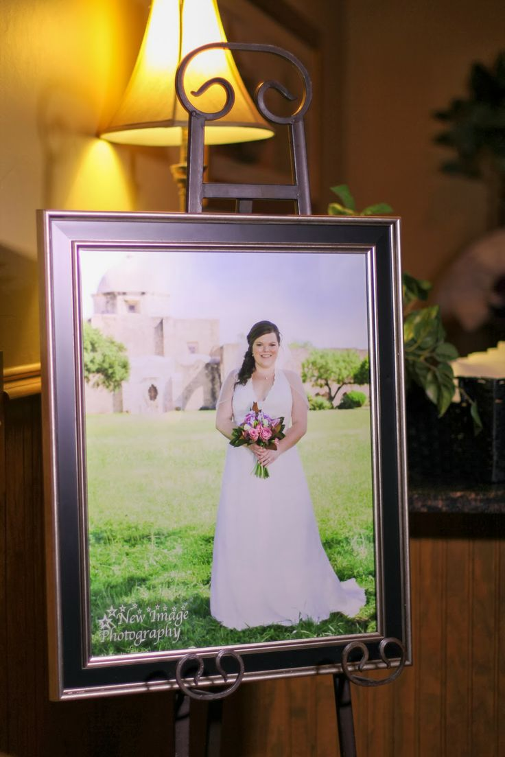 Bridal portrait display at wedding reception new image for How to take wedding photos
