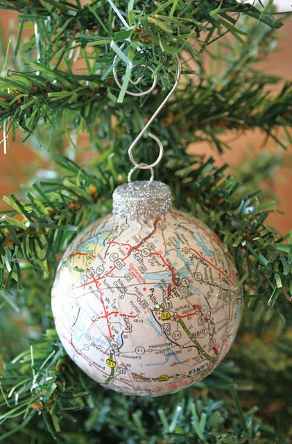 Decoupage ornaments featuring maps of places we've visited throughout the year