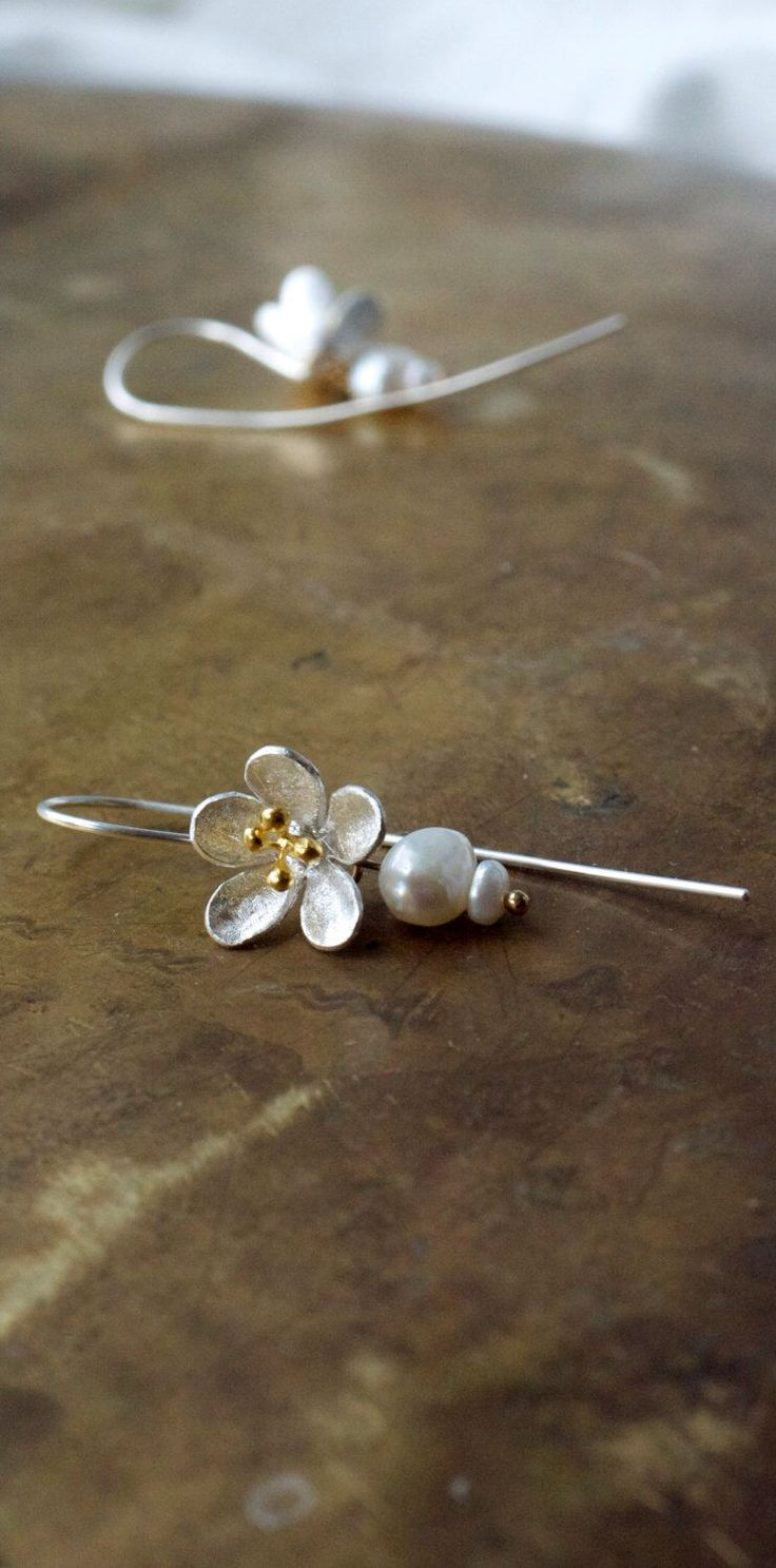 Modern bridal pearl earrings Mixed metal flower earrings Gold and silver earrings Cherry flower Sakura jewellery Floral bridesmaid earrings by ThePillowBook on Etsy https://www.etsy.com/listing/220760948/modern-bridal-pearl-earrings-mixed-metal