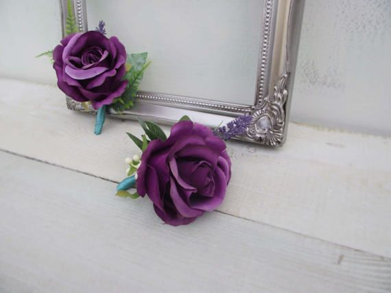 Artificial wedding flowers, groom and best man buttonhole set of 2. Large natural looking purple rose decorated with cream wild berry, some greenery and finished with lovely turquoise satin ribbon. Perfect for rustic, shabby chic wedding. Will also suit classic style wedding.  Made to impress. Made with love.  FREE delivery when bought with a wedding bouquet.   Click on the shop name above (Facaldoflowers) or use this link for more wedding flowers made by myself:  www.etsy.com/uk/sh...
