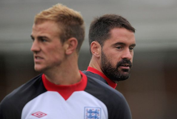 Scott Carson Photos Photos - Joe Hart (L) and Scott Carson look on during the England training session on November 14, 2011 in London Colney, England. - England Training And Press Conference