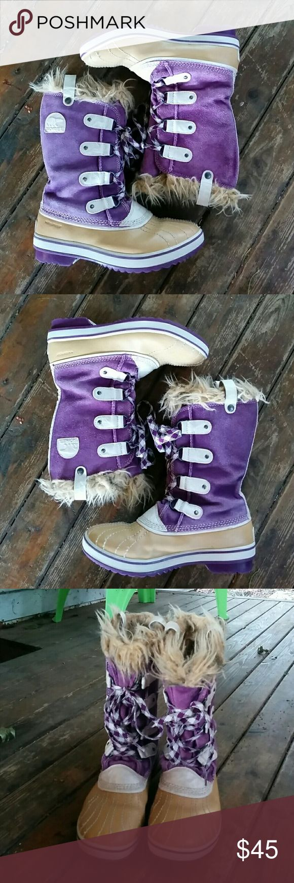 Sorel winter boots Just in time for Fall, Sorel faux fur lined winter boot. Rubber bottoms purple suede uppers. Suresh does have some fading from wear, and the fur is a bit mattress. Soles after great! Overall nice boots!! Size 5. Sorel Shoes Winter & Rain Boots