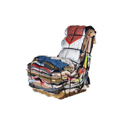 Seriously- $6,785 but you get free shipping.  The Rag Chair is serious about recycling. Layered from the contents of 15 bags of rags, the Rag Chair reuses clothes that would otherwise be thrown out. The Rag Chair arrives ready made, no assembly required. Metal strapping is used to anchor the rags in the shape of a chair. Each Rag Chair is unique with the fabric prints and colors used.  Rag Chair