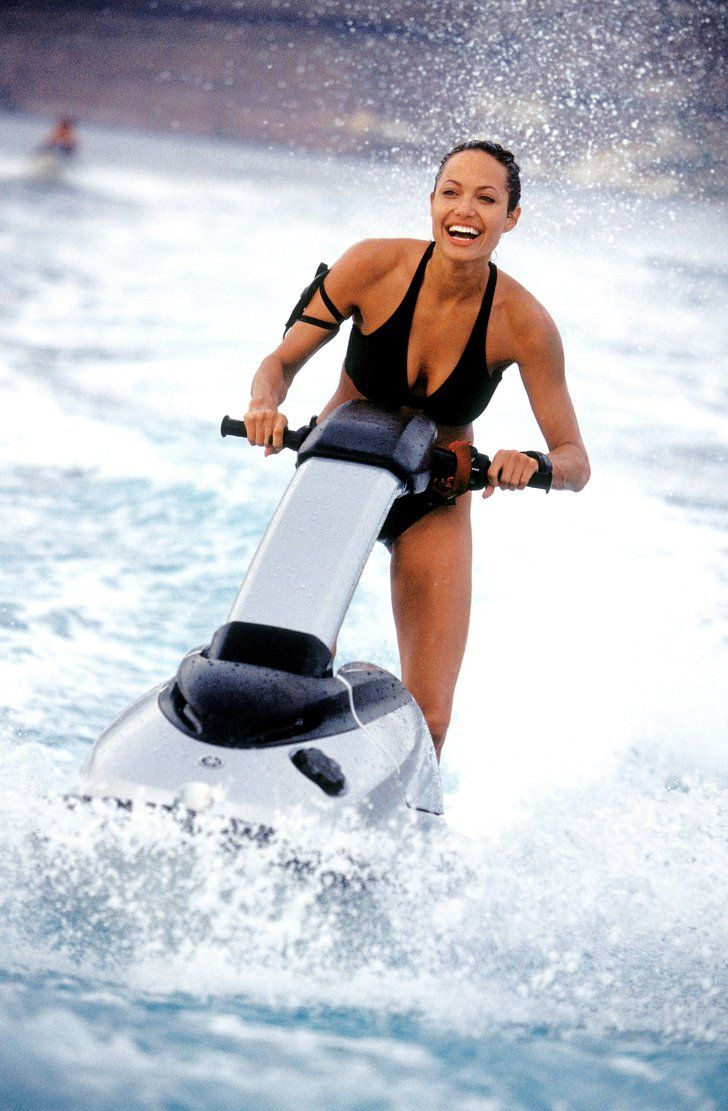 Angelina was all smiles in her swimsuit as she played Lara Croft in | Look Back at Angelina Jolie's Sexiest, Most Scintillating Pictures Through the Years | POPSUGAR Celebrity
