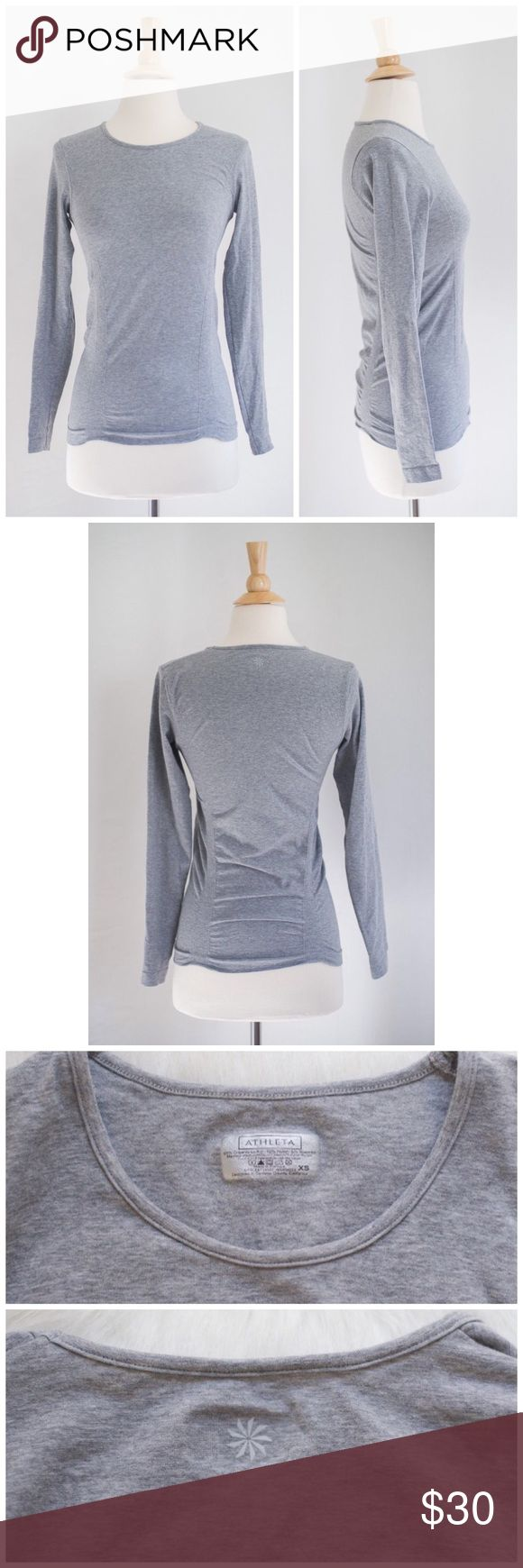 Athleta Fastest Track Long Sleeve Top Excellent, pre-owned condition.  No flaws.  85% Organic Cotton, 10% Nylon, 5% Spandex.  Color: Heathered Grey.  Your favorite, go-to training top for high-intensity sweat sessions has our best technologies: Unstinkable, Regul8, and chafe-free seamless fabric. 	•	INSPIRED FOR: run, gym/training, studio workouts 	•	Raglan sleeves give you room to move 	•	Shirring along the sides is fit to flatter 	•	Gripper dots along hem stop it from riding up Athleta…