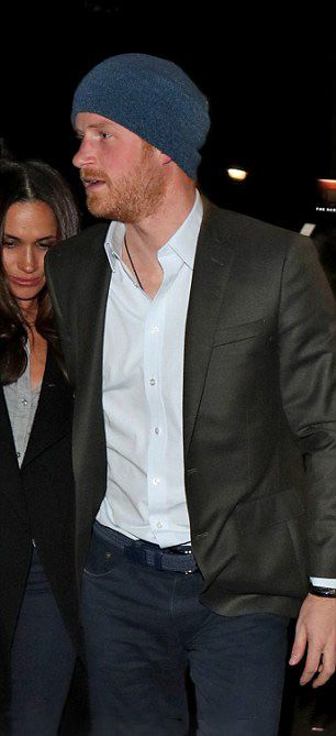 Prince Harry was wearing a black blazer jacket and dark blue chinos when he walked with his girlfriend Meghan Markle.