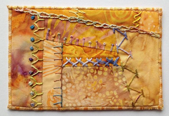Gold Fabric Postcard, Crazy Quilt Hand Embroidered Postcard, Fibre Art Postcard, Textile Art Postcard, Quiltsy Handmade Fiber Art Postcard  -------------------------------------- This fabric base for this one-of-a-kind postcard is made of 100% cotton batik fabrics. In traditional crazy-quilt style, each seam in the block is embellished with a different hand embroidered stitch. The stitching is done with a variety of silk and cotton threads and ribbons. The back of the postcard is printed…