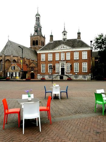 Chair Outdoors Architecture No People Sky Day Church Tower Church Architecture Steetphotography Chairs And A Table Colorsplash Square Bricks Town Square