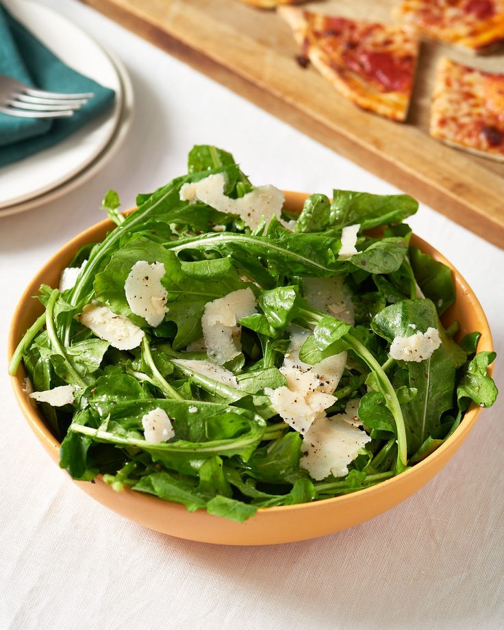 A quick and easy, unfussy arugula salad tossed in a lemon vinaigrette and finished with shaved Parmesan.