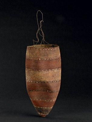 Girl's dilly bag made of pandanus fibre, wool, feather, resin. Australia