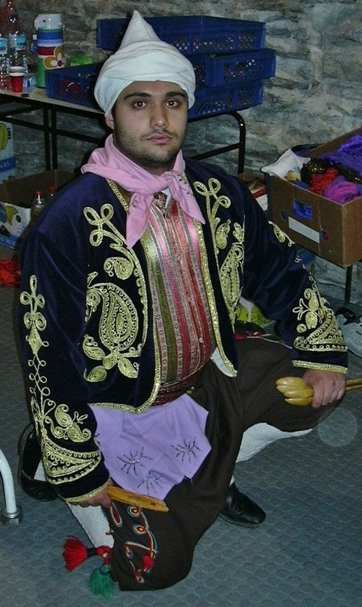 Traditional festive costume from the Silifke region (Íçel province).  Ethnic group: Yörük.  Clothing style: mid- 20th century.  This costume is a workshop-made copy (1996), as worn by folk dance groups.  Both embroidered kerchiefs, the silk 'kuşak' (waist band) and the 'çarpana kemer' (tablet-woven belt) are authentic (c. 1925-1950).  /Orhan GENEL