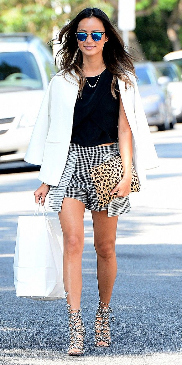 Jamie Chung wears animal print with a crop top, printed skirt, and white blazer