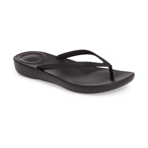 Women's Fitflop Iqushion Flip Flop (€27) ❤ liked on Polyvore featuring shoes, sandals, flip flops, all black, bubble flip flops, arch support flip flops, black slip resistant shoes, arch support shoes and black flip flops