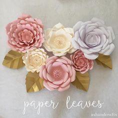15 Fun DIY Paper Flower tutorials.: Paper Flower Backdrop and Leaf Tutorial
