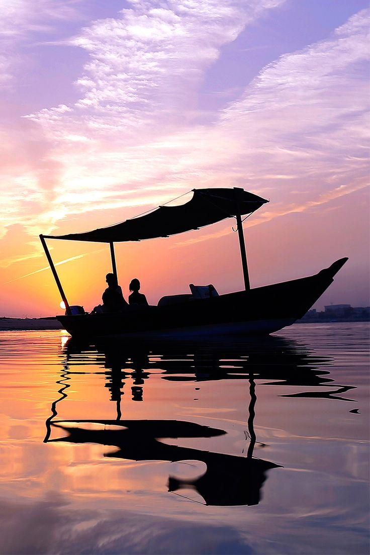 Romantic sunset on a river cruise in Ras Al Khaimah Beach resort