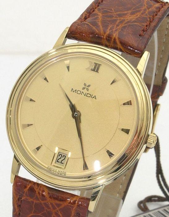 Mondia Zenith-Men's watch in 750/1000 geel goud - Quartz horloge - Late jaren 1990 - Quartz-New  Mooie vrouwen geel gouden horloge quartz uurwerk late jaren 1990 nieuw met doos en garantie nog ingevuld te worden want het komt vanuit een magazijn van de winkel.955112 ETA quartz uurwerkDiameter: 33 mm (excl. kroon)Dikte: 5 mmLicht gebogen kristalChampagne gekleurde wijzerplaat met gouden uur markeringen en handen.Datum venster om 6 uur.Originele band in echt krokodillenleer met gele vergulde…
