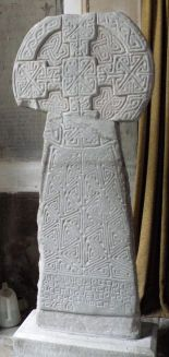 """Houelt Cross in Llantwit. It has an inscription in Latin, translated as """"In the name of God the Father and of the Son and of the Holy Spirit, Houelt prepared this cross for the soul of Res his father"""". It is around ninth century."""