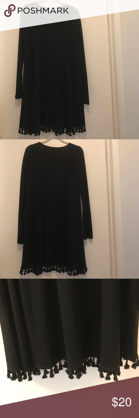 Long sleeve black tunic dress Super cute long sleeve tunic dress with tassel detail. Only worn one time! Purchased from a boutique Dottie Couture  Dresses Long Sleeve