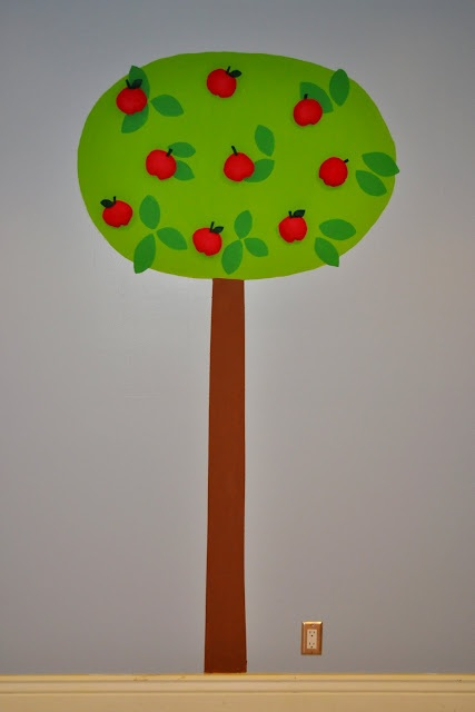 Interactive playroom apple tree; they later added a ladder and basket for easier picking of the apples.
