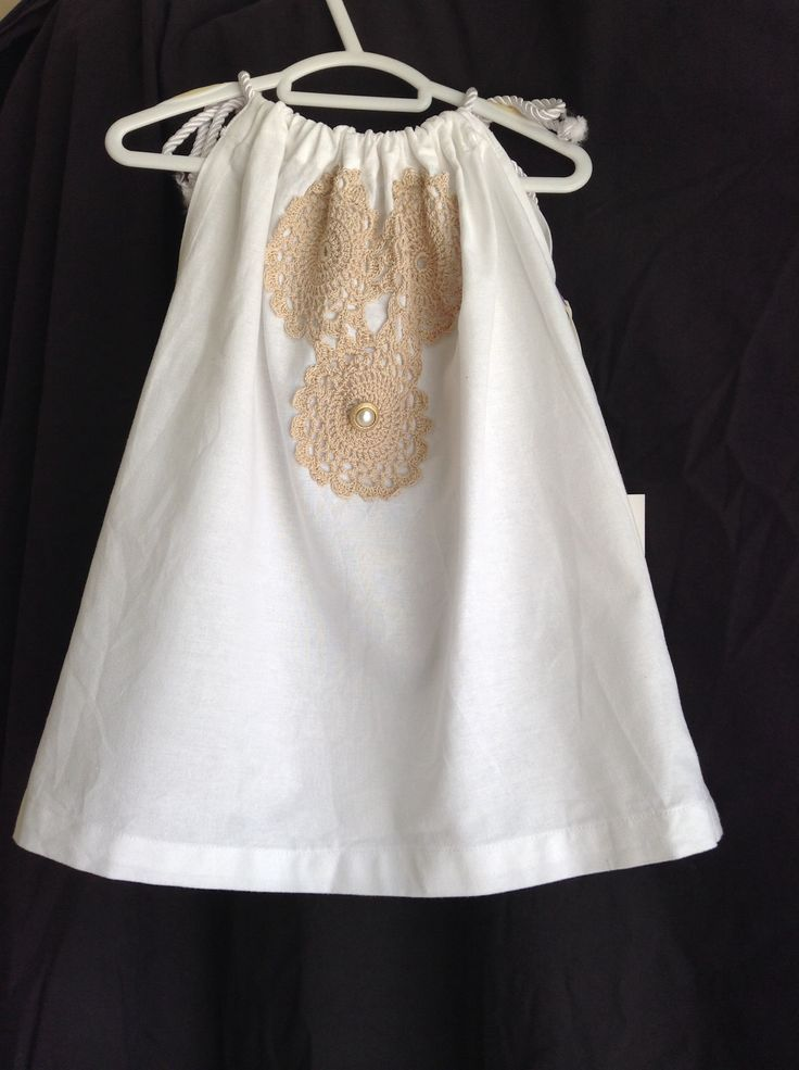 One of the new dresses from our 'Stella Bella collection'. White cotton pillow slip style dress with vintage doilie & antique pearl/gold button. For that special occasion. www.facebook.com/littlemisslolas