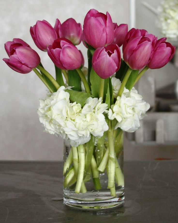 Tulips & Hydrangeas Centerpiece. Now thinking of a shorter square glass vase with yellow tulips and white roses where the hydrangeas are in picture. To match bridal and bridesmaids bouquets.