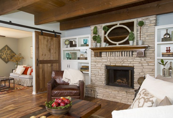 As seen on HGTV's Fixer Upper - wider shot of framed mirror above fireplace