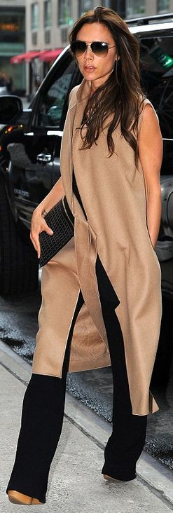 Who made Victoria Beckham's aviator sunglasses, tan sleeveless coat, brown wedge sandals, and black clutch handbag that she wore in New York?