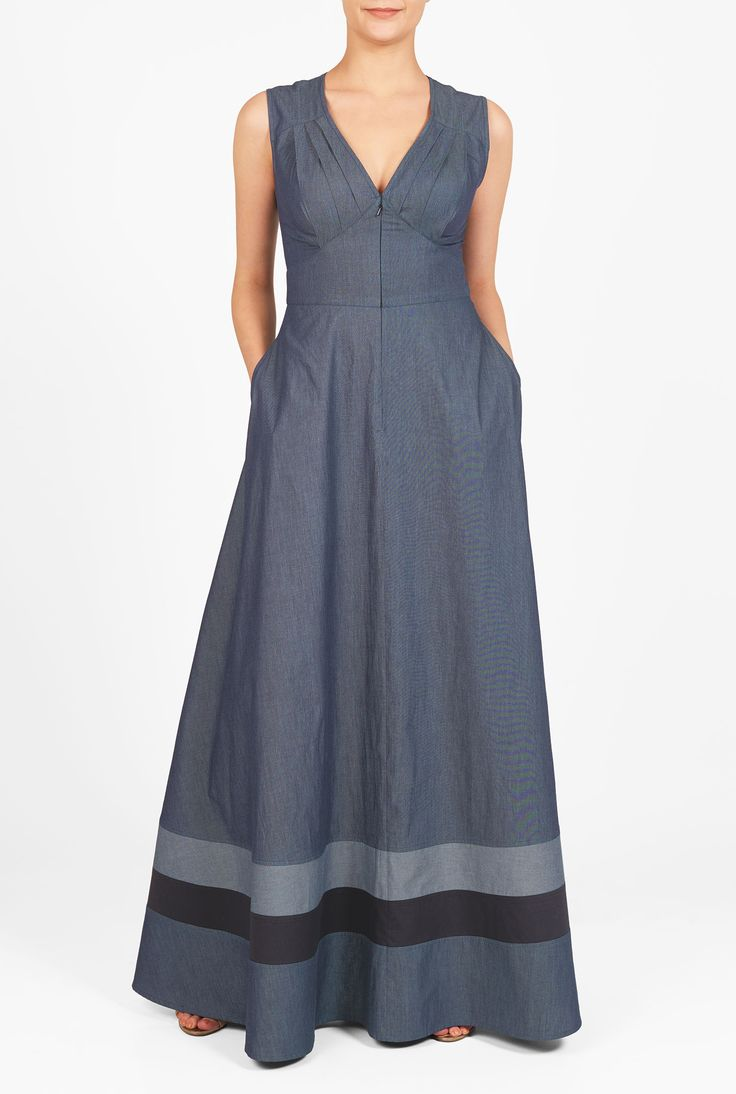 Cotton chambray falls gracefully into the pleated bodice and flowing skirt with contrast banded stripe hem of our maxi dress accented with a wide banded empire waist.