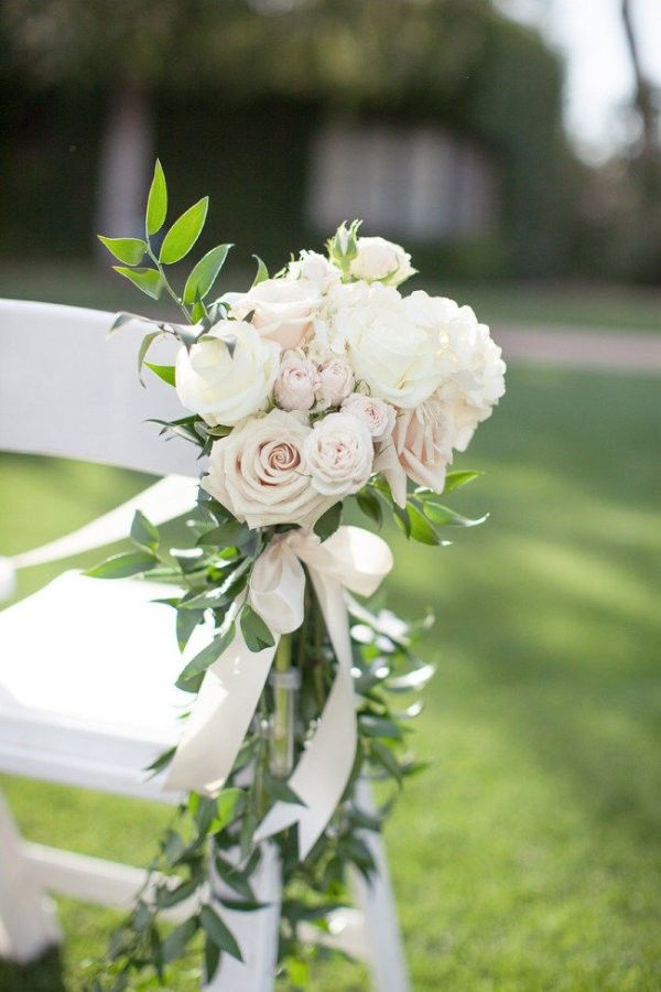 flowers decorated wedding chairs for ceremony