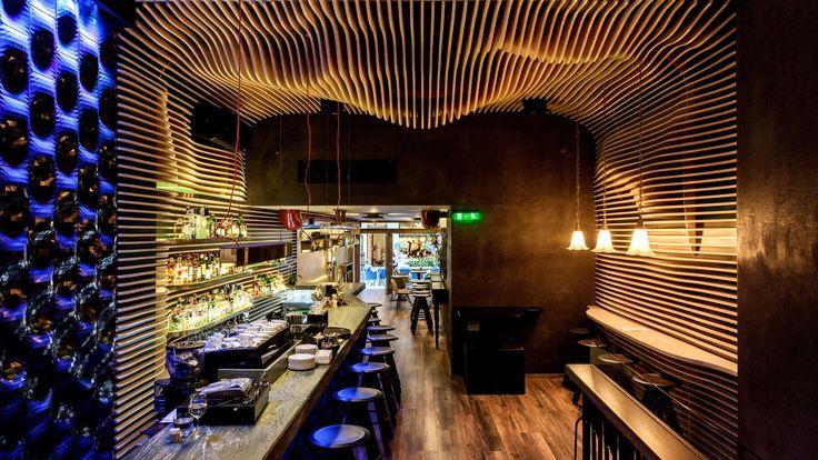 The Vibes : Ξύλινες ειδικές κατασκευές, κυματοειδής ξύλινη επένδυση σε τοίχους και οροφή, κατασκευή σκάλας και έπιπλα για το cafe bar »The Vibes Ain't Nothing But The Vibes» επί της Προξένου Κορομηλά. - See more at: http://masterwood.gr/portfolio/the-vibes/#sthash.8ZKcuYg4.dpuf