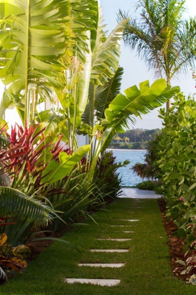 Walkway through tropical garden in Palm Beach, Florida | Island cocktail reception inspiration ~ Vacation Rental Lodging: http://PalmBeachCountyVacationRental.com