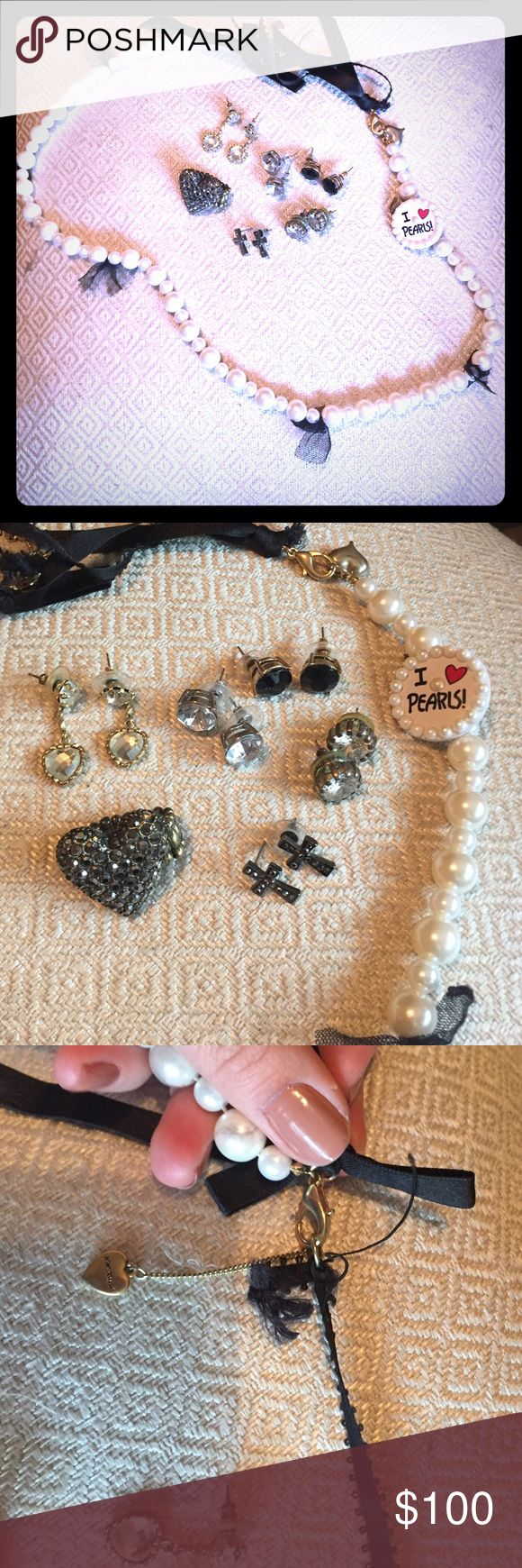 GIANT LOT OF BETSEY JOHNSON JEWLERY GIANT LOT OF ALL AUTHENTIC BETSEY JOHNSON JEWELRY! Five lies of Earrings, one ring and one necklace. The necklace had a ribbon detail that snagged a bit but you can't even tell. You could trim the tail accordingly how you wish. I did, and it hits there nacho anyway! Really great value. Well worth over $200. Necklace 48, diamanté framed earrings 40, cross studs 25, heart drop hearings 40, set of clear and black diamond studs, 40 and ring 40. Betsey Johnson…