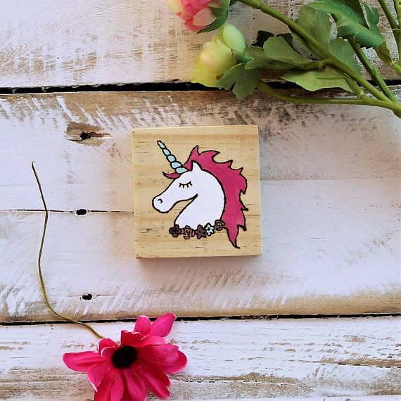 Decorate your space with whimsy and little bit of magic. This small unicorn sign will add a bright spot to your desk, nursery, bookshelf, or nightstand. Combine rustic with rainbows, and youll happily blend your style with this unique unicorn sign.   - Place this beautiful unicorn anywhere! Its small 3x3 size will accent your desk and stand out as a unique decoration thats manageable and cute - Painted with bright acrylics (pinks, white, light blue, and purple), feelings of whimsical joy…