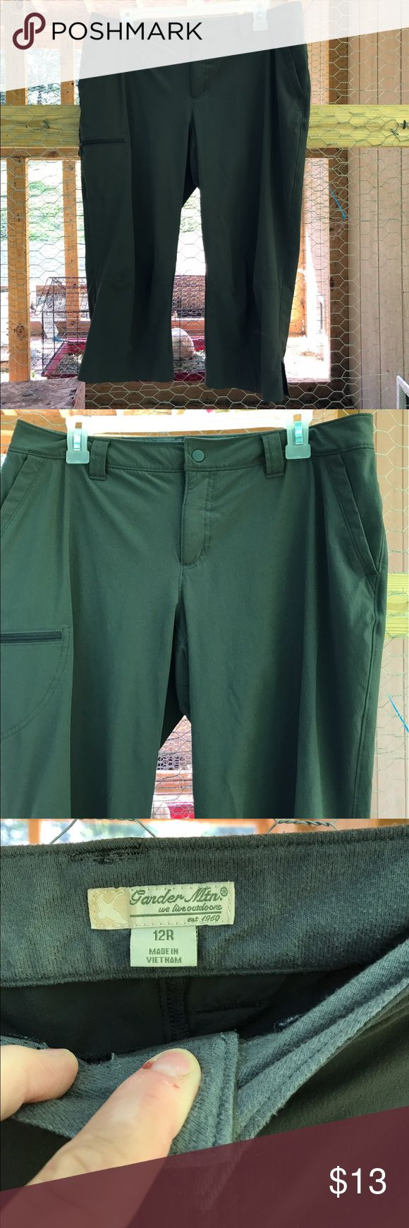 Gander Mountain Dark Green Women's Capris Sz 12 R Gander Mountain women's dark Army green capris are size 12R. Inside waist is a soft material. Capris have belt loops, 2 slash pockets, 3 zip pockets and closes with a snap and zipper. One zippered pocket is on right leg and other 2 in back. There are slits in each side of legs. Made in Vietnam of 86% nylon 14% spandex. All pockets are Mesh lined. Color is close to the first picture. Gander Mountain Pants Capris