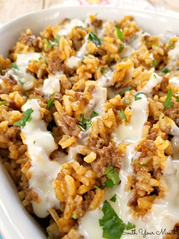 Taco Rice Skillet Dinner with Queso! A one-pan recipe made with ground beef, tac…