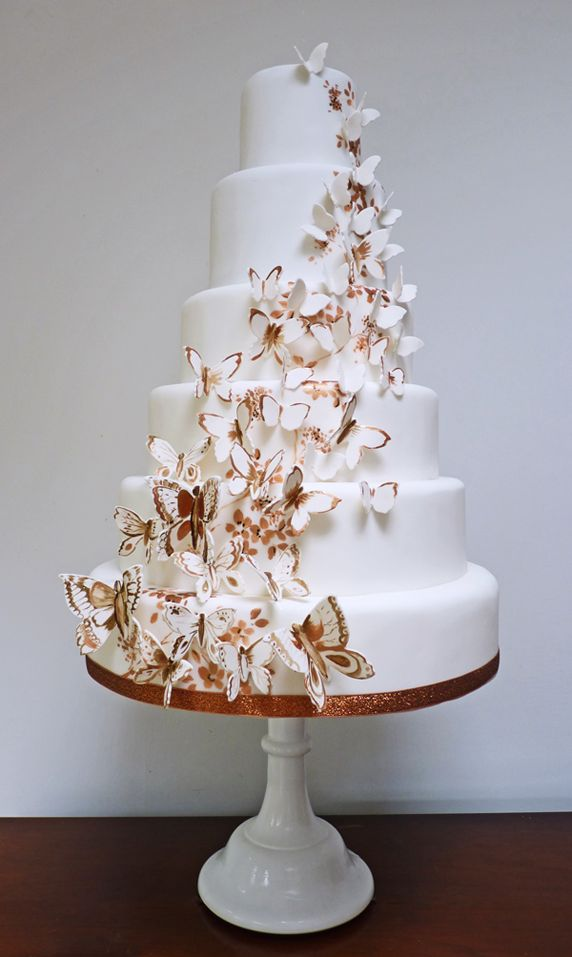 This was made as a 40th Birthday Cake with Forty Butterflies!  What a cute idea, and beautiful cake! It would make a beautiful wedding cake as well, especially for an outdoor Spring wedding!