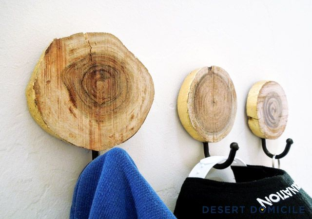 DIY Gold Leaf Wood Slice Coat Hangers – Don't need any coat hangers? Make one anyway but hang it in your bathroom to hold your hand towel instead! #diy #goldleaf #coathanger