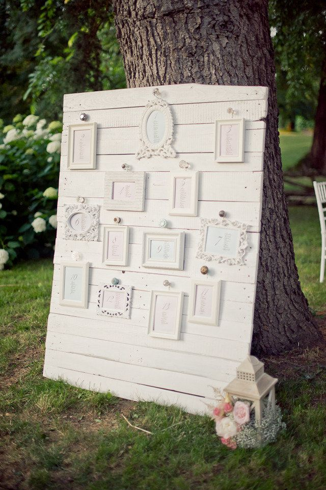 Seating chart idea for rustic or shabby chic wedding. Vintage inspired frames with seating assignments on old wood board. Really budget friendly!