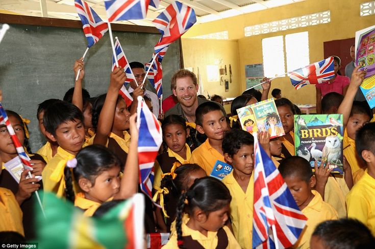It is all smiles as Harry enjoys seeing what the children are learning and their flag display for him