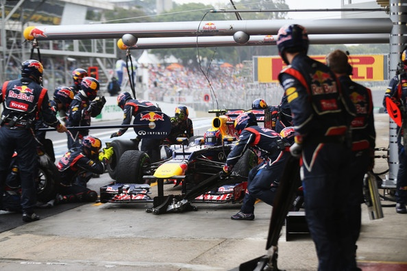 Mark Webber of Australia and Red Bull Racing drives in for a pitstop during the Brazilian Formula One Grand Prix